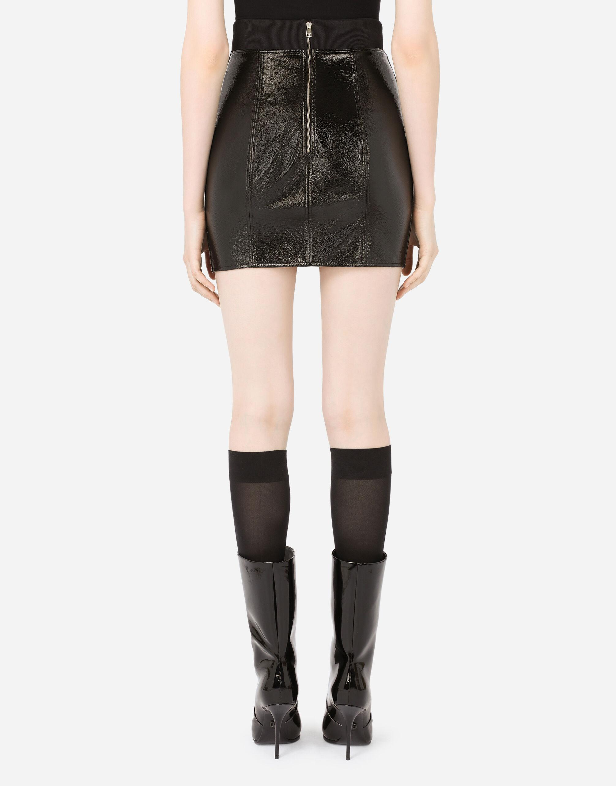 Coated cotton miniskirt with laces and eyelets 1
