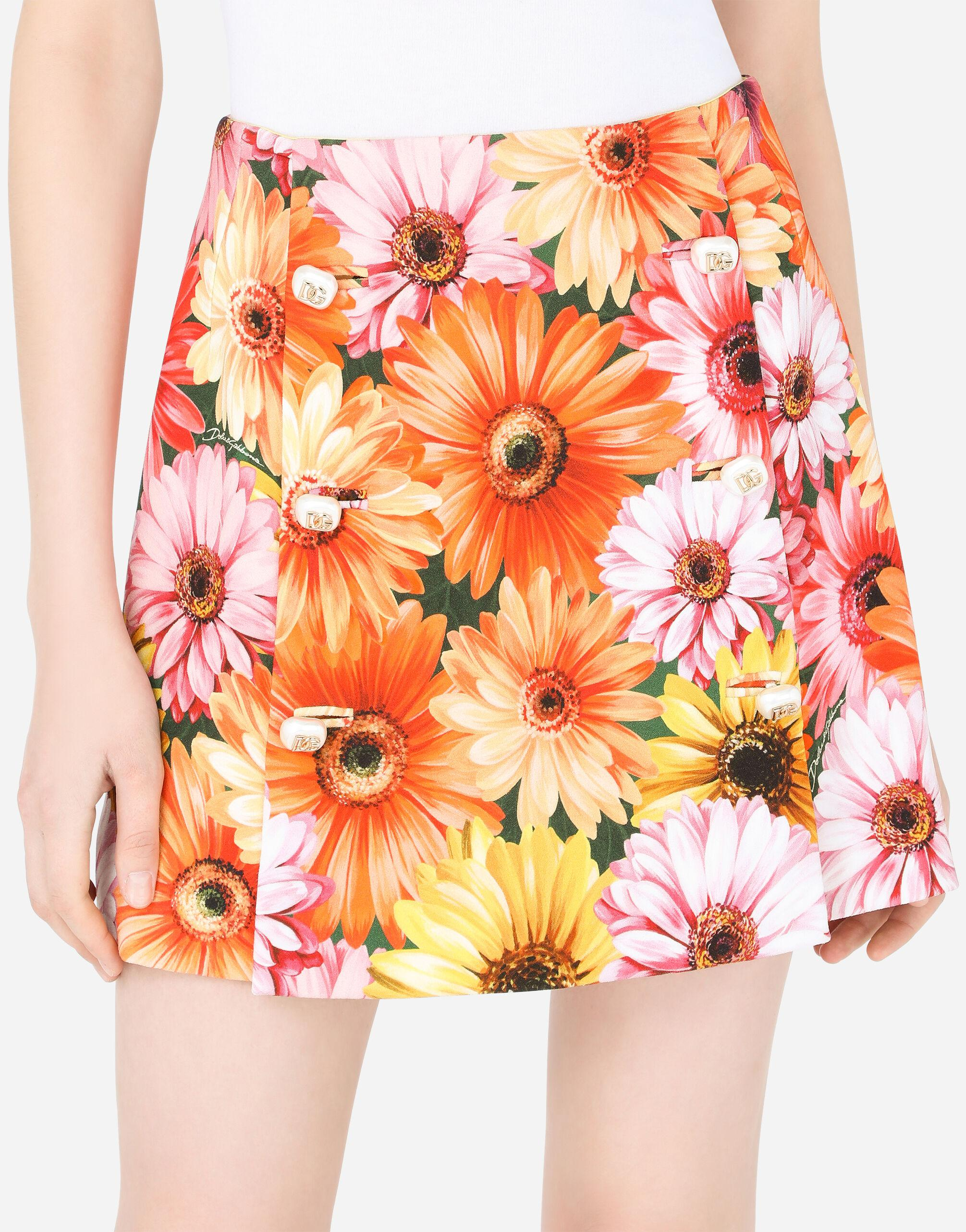 Cady miniskirt with gerbera-daisy print and decorative pearl DG buttons 2