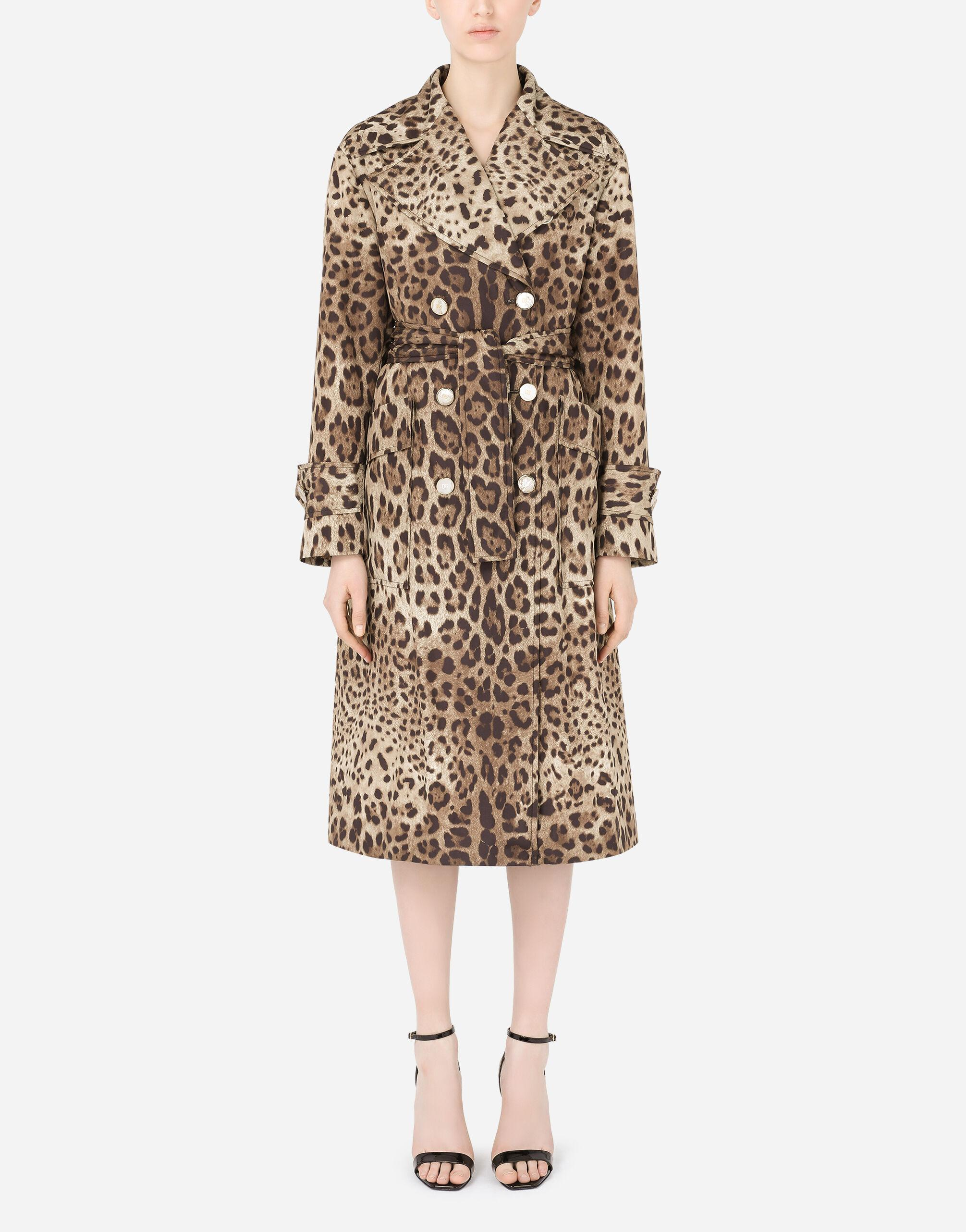 Belted double-breasted padded nylon trench coat with leopard print