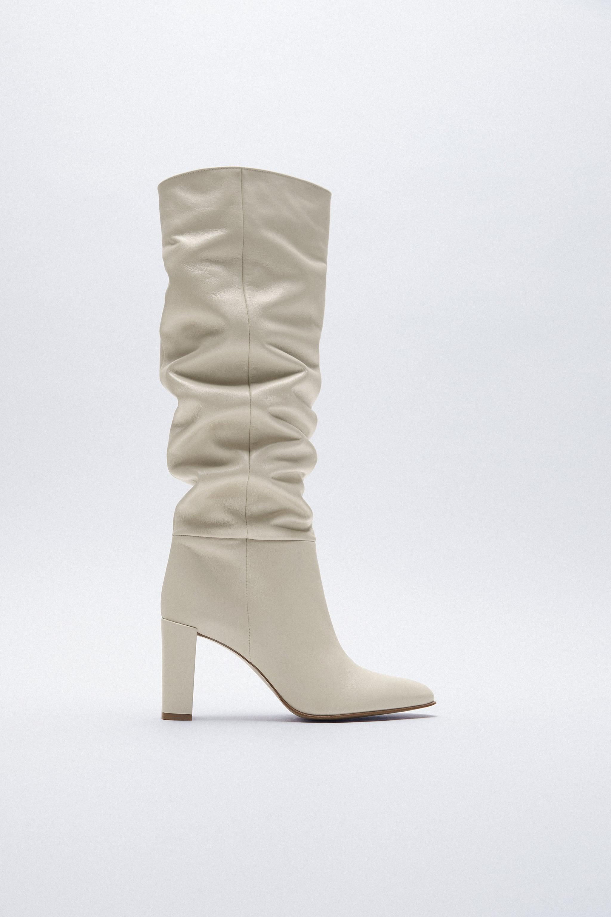 HIGH SHAFT HEELED LEATHER BOOTS