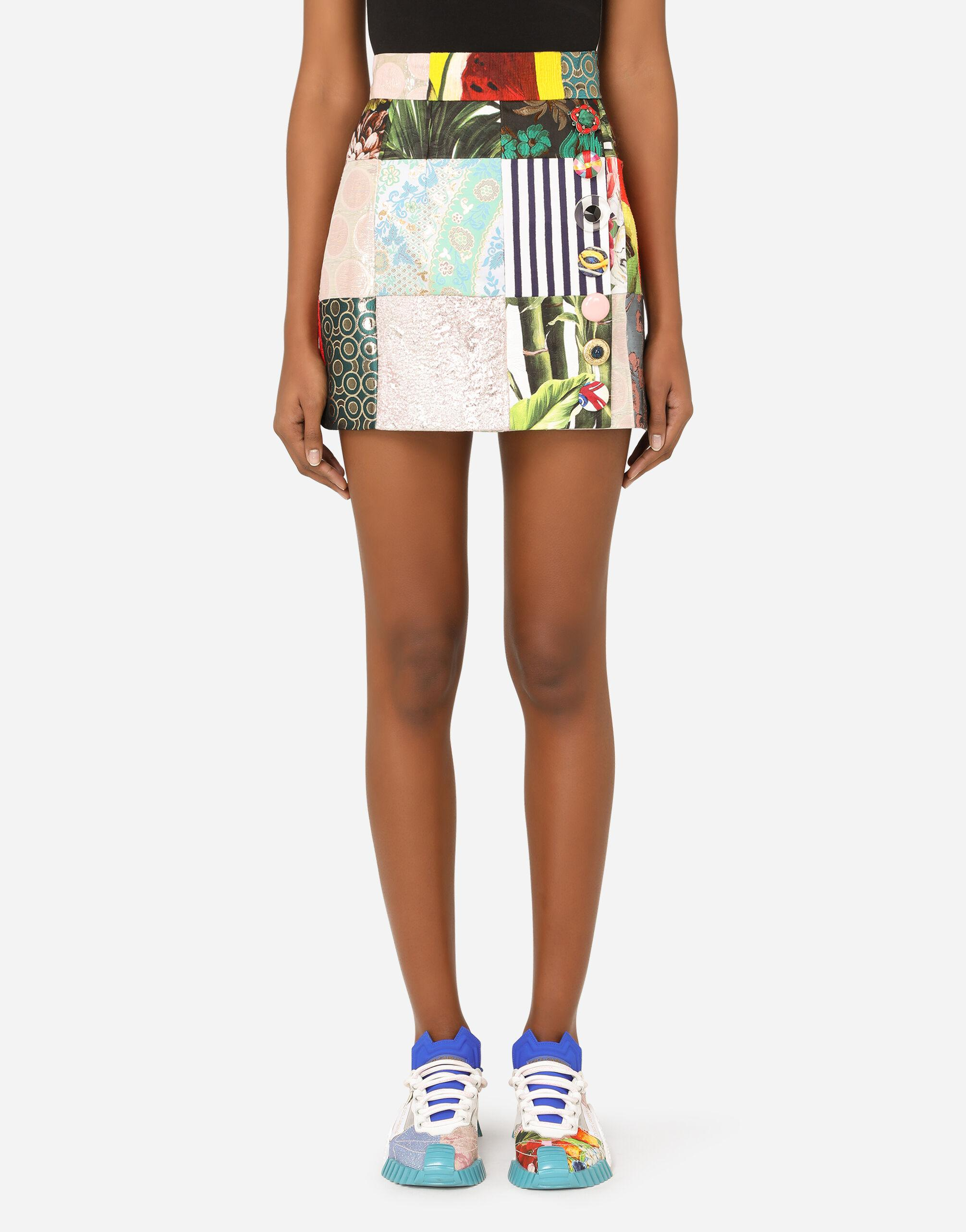 Patchwork jacquard miniskirt with bejeweled buttons