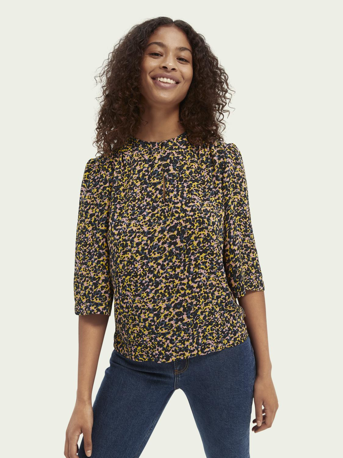 Printed piped-detailing top