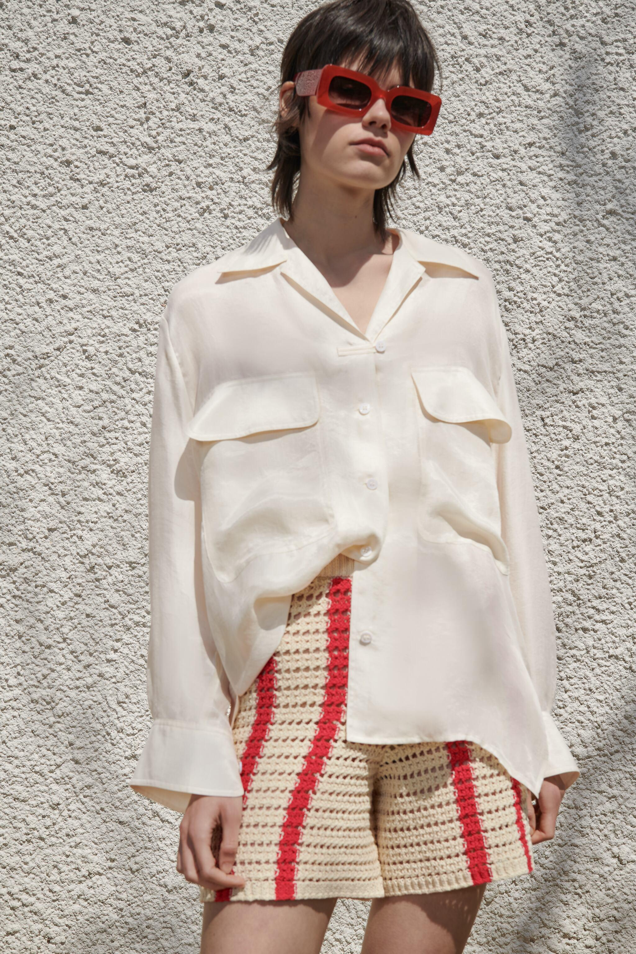 FLOWY BLOUSE WITH POCKETS