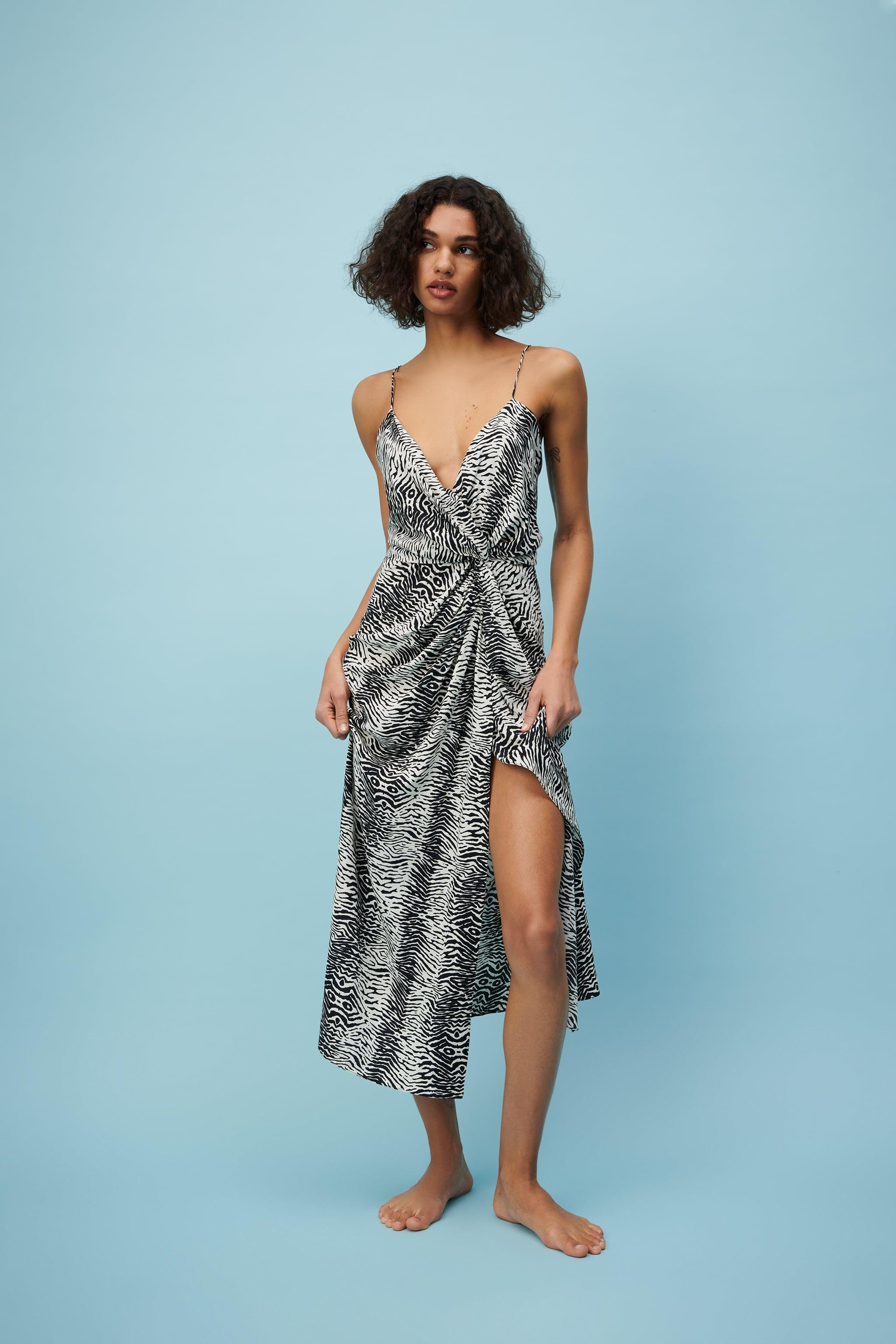 PRINTED DRESS WITH DRAPING