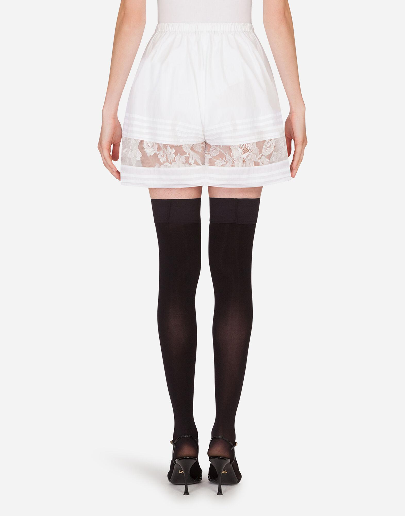 Silk shorts with lace details 1