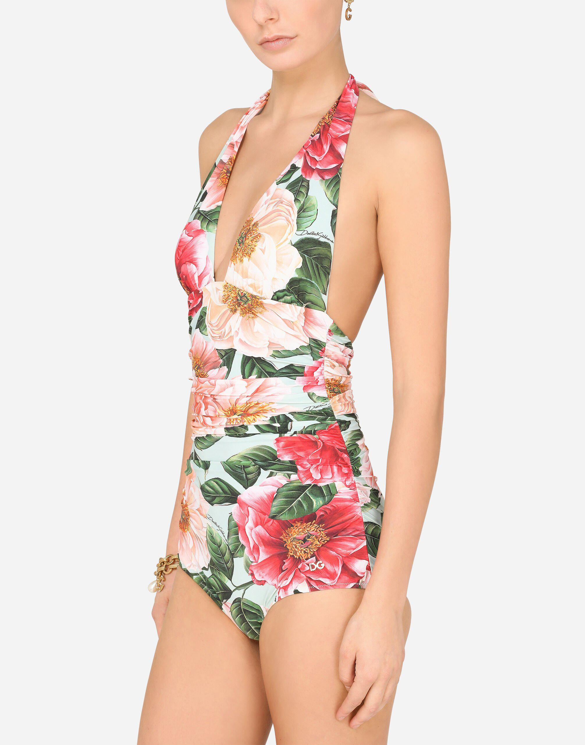 Camellia-print one-piece swimsuit with plunging neckline 1