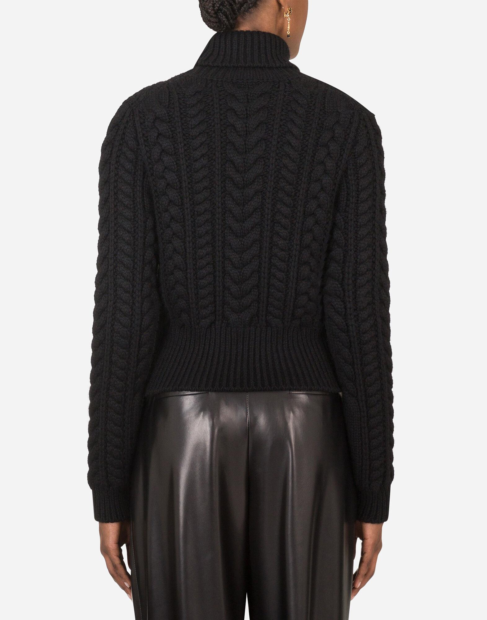 Cable-knit cashmere turtle-neck sweater 1